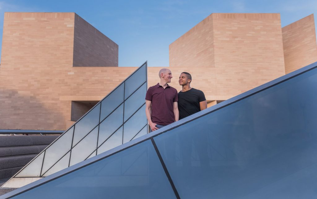 Gay engagement shoot in front of the Glass Pyramids at the National Gallery of Art in Washington, DC.