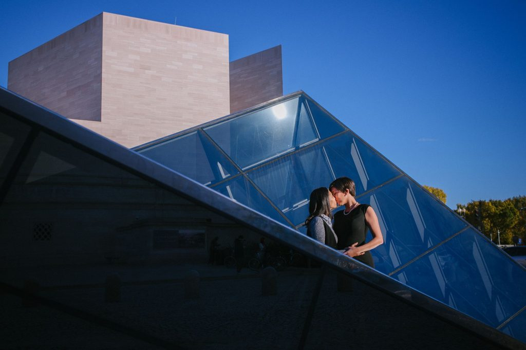 Lesbian engagement shoot in front of the Glass Pyramids at the National Gallery of Art in Washington, DC.