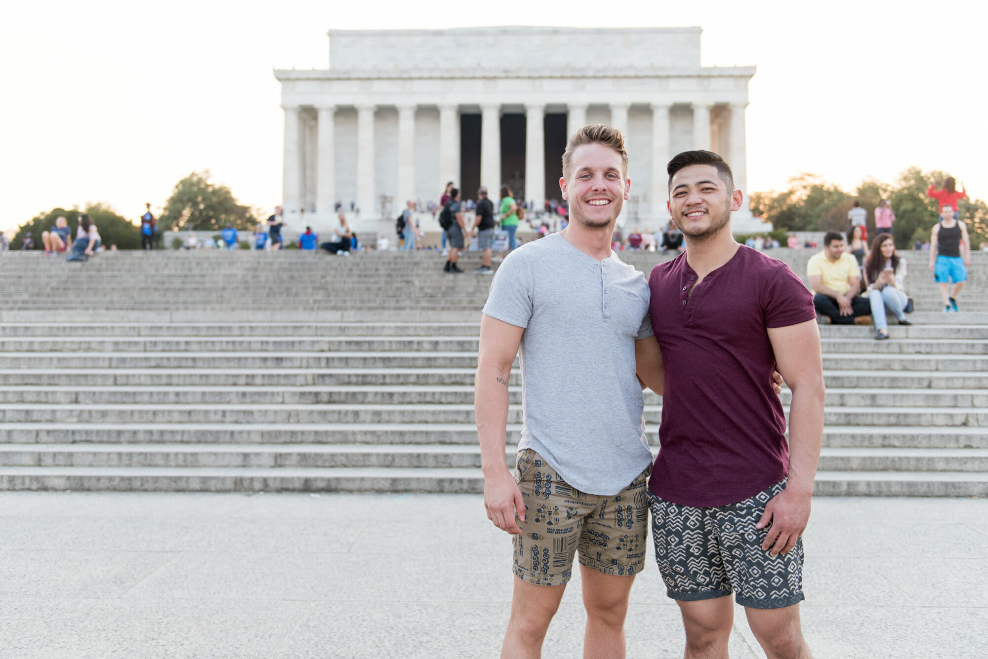 Gay LGBT couple posing in front of the Lincoln Memorial on the National Mall in Washington, DC