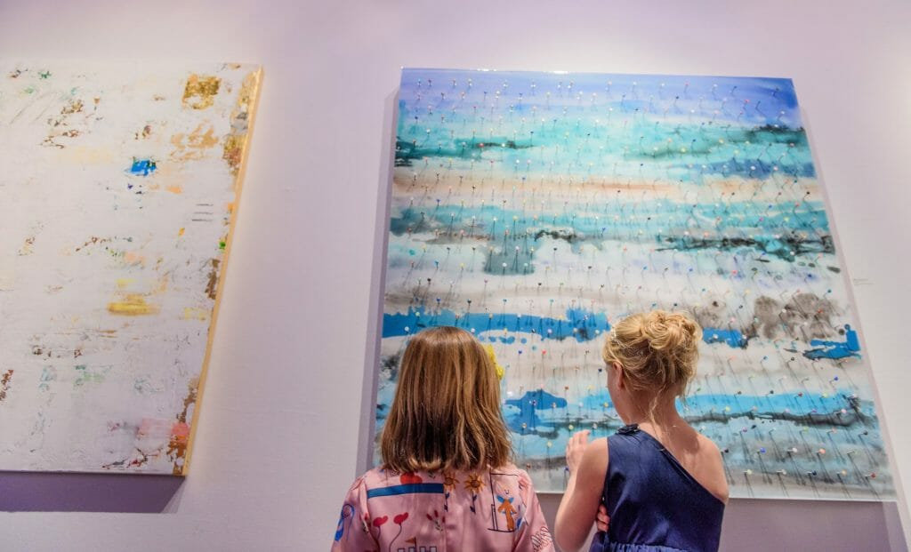 Long View Gallery DC LGBT Wedding Portraits Two Grooms Kids looking at paintings