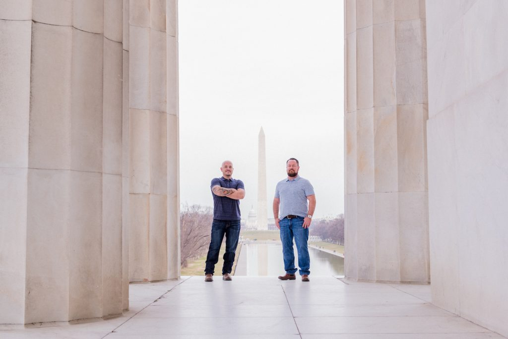 Gay engagement shoot at the Lincoln Memorial in Washington, DC, with the Washington Monument in the background.